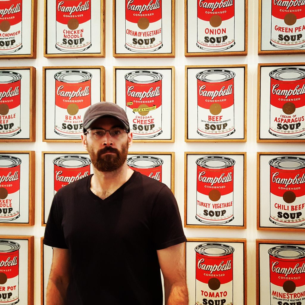 Portrait at MoMA with Andy Warhol's Tomato Soup Cans